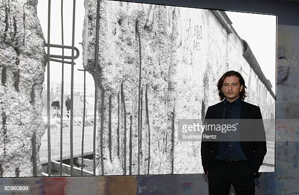 Manuele Malenotti Vice president of Belstaff poses in front of a video display that shows images from the former Berlin wall at the 10th World Summit...