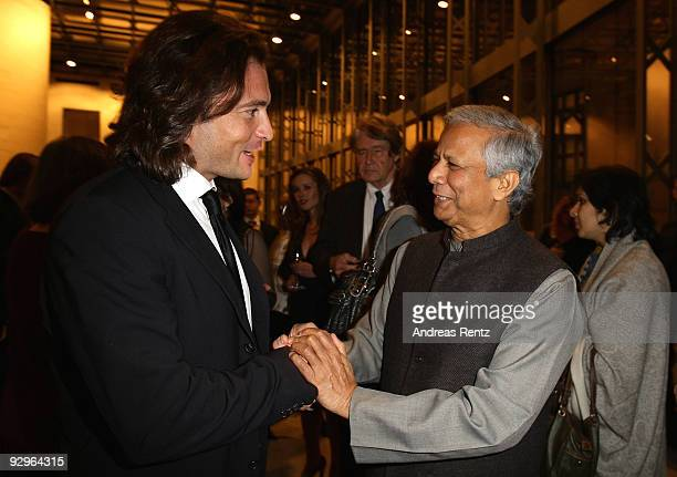 Manuele Malenotti vice president of Belstaff shakes hands with economist Muhammad Yunus at the gala dinner BELSTAFF FOR PEACE to the 10th World...