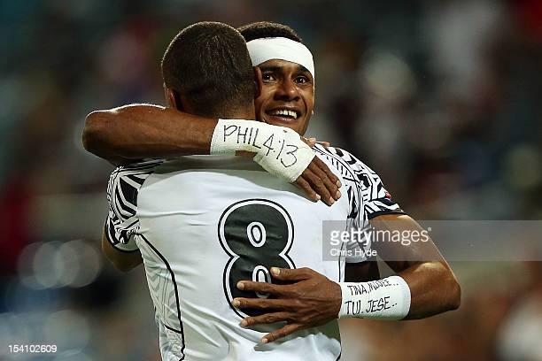 Manueli Taubale Lagai and Ulaiyasi Lawavou Tavucuilagi of Fiji celebrate winning te Cup Final between Fiji and New Zealand during day two of the 2012...
