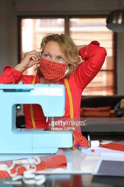 manufacture of protective masks during the coronavirus pandemic, covid-19 - ribbon sewing item stock pictures, royalty-free photos & images