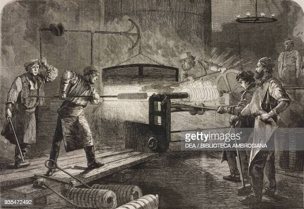 Manufacture of the Armstrong gun at Woolwich Arsenal coiling the bars United Kingdom illustration from the magazine The Illustrated London News...