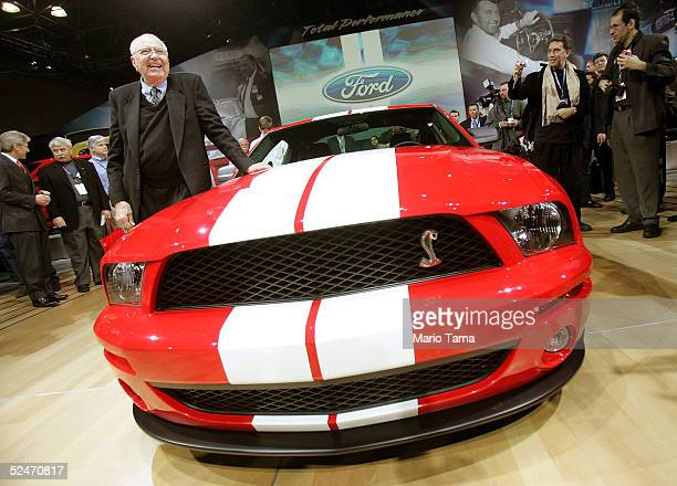 Manufacturer and automotive legend Carroll Shelby stands next to the Ford Shelby Mustang Cobra GT500 at the 2005 New York International Auto Show...