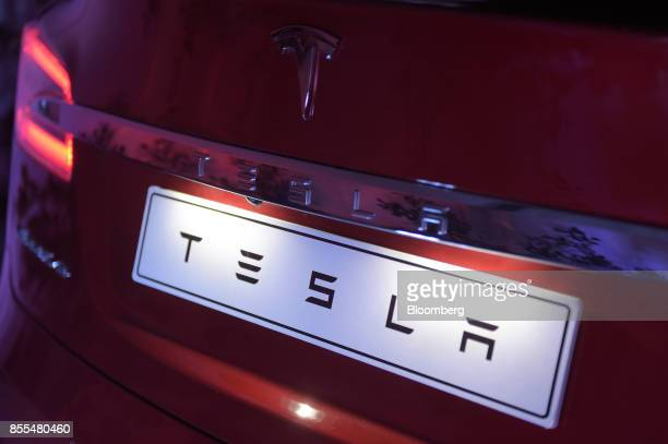 A manufacturer's name plate sits on a Tesla Model S electric vehicle during a Tesla Inc event at the Hornsdale wind farm operated by Neoen SAS near...