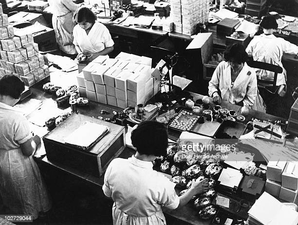Manufacturing easter eggs at the Cadbury factory at Bourneville in Birmingham c1940s Manufacturing easter eggs at the Cadbury factory at Bourneville...