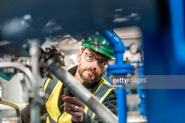 Manufacturing worker analysing machines at factory