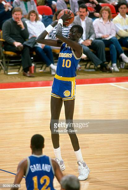 Manule Bol of the Golden State Warriors looks to shoot against the Washington Bullets during an NBA basketball game circa 1989 at the Capital Centre...