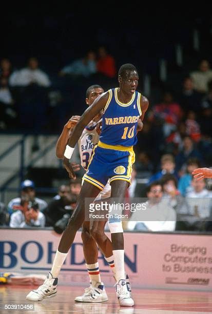Manule Bol of the Golden State Warriors works for position on Bernard King of the Washington Bullets during an NBA basketball game circa 1989 at the...