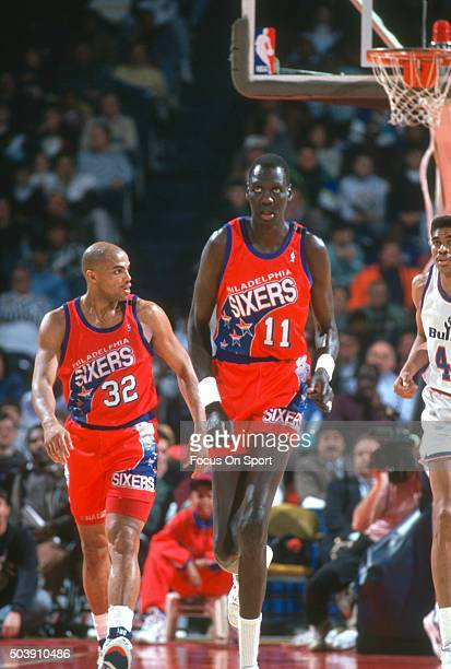 Manule Bol of the Philadelphia 76ers in action against the Washington Bullets during an NBA basketball game circa 1992 at the Capital Centre in...