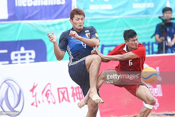 Manus Martha of Thailand competes for the ball with Takuya Akaguma of Japan during the Continental Beach Soccer Tournament match between Japan and...