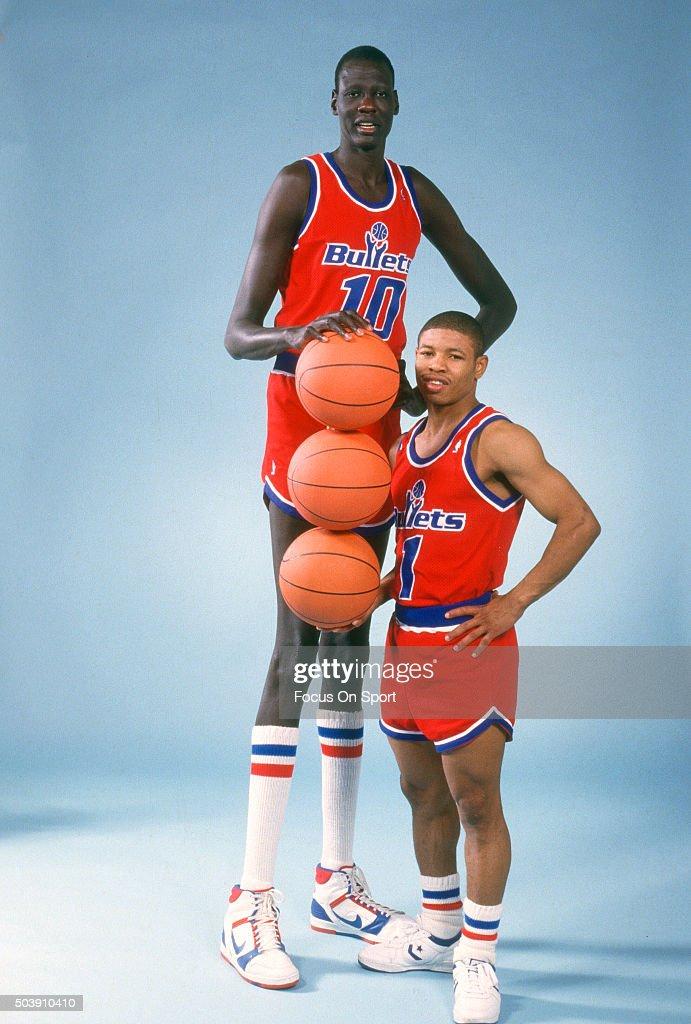 78d416cd5294 Manute Bol and Muggsy Bogues of the Washington Bullets poses ...