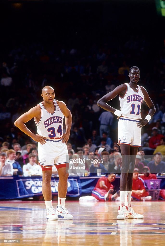 e56552bbd Manute Bol and teammate Charles Barkley of the Philadelphia 76ers ...
