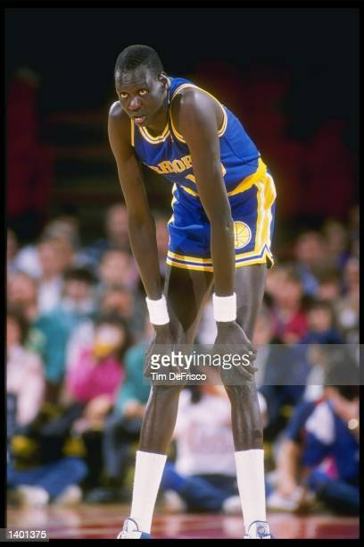 Manute Bol of the Golden State Warriors looks on during a basketball game Mandatory Credit Tim de Frisco /Allsport