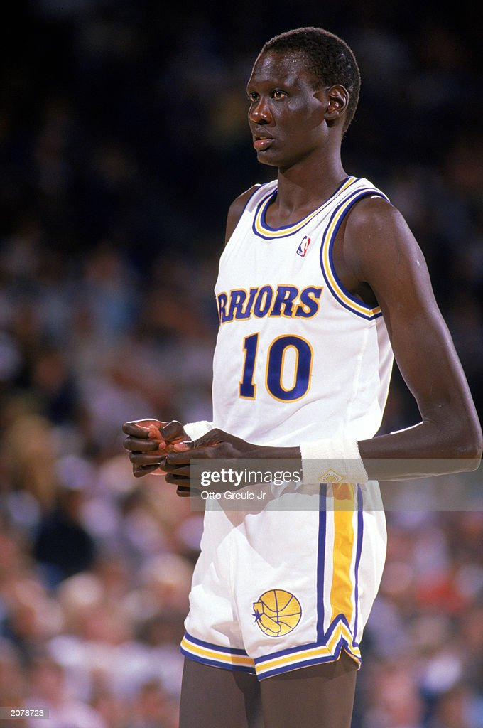 1b033588c8d4 Manute Bol of the Golden State Warriors looks on during an NBA game ...