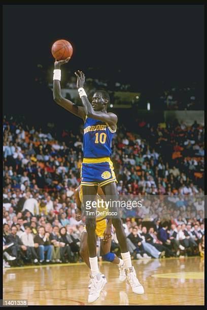 Manute Bol of the Golden State Warriors shoots the basketball Mandatory Credit Tim de Frisco /Allsport
