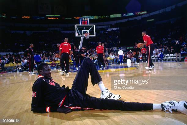 Manute Bol of the Miami Heat stretches during a game played on January 12 1994 at the Arena in Oakland in Oakland California NOTE TO USER User...