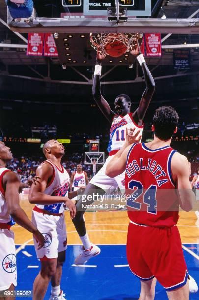 Manute Bol of the Philadelphia 76ers dunks against the Atlanta Hawks circa 1993 at the Spectrum in Philadelphia Pennsylvania NOTE TO USER User...