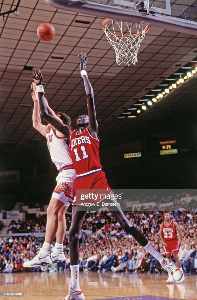 a3cbdbbde Manute Bol of the Philadelphia 76ers rebounds against the Phoenix ...