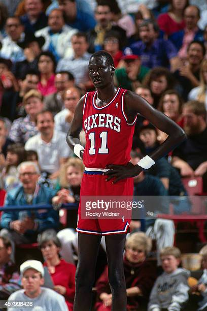 Manute Bol of the Philadelphia 76ers stands against the Sacramento Kings on February 14 1991 at Arco Arena in Sacramento California NOTE TO USER User...