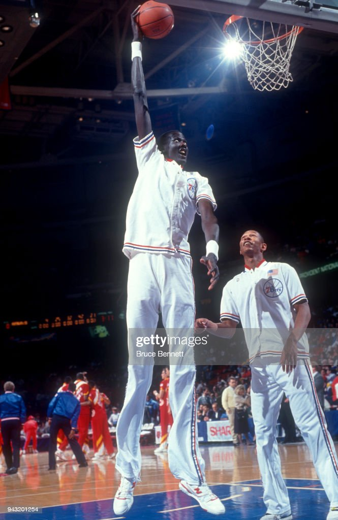 269bb18d6c2 Manute Bol of the Philadelphia 76ers takes a shot during warm-ups as ...