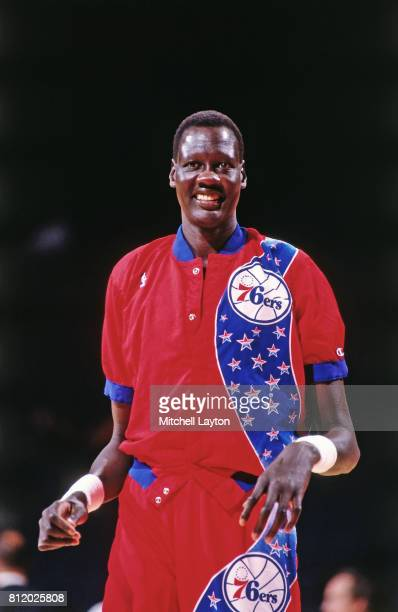 Manute Bol of the Philadelphia 76ers warms up before a game at the Spectrum in Philadelphia Pennsylvania circa 1993 NOTE TO USER User expressly...