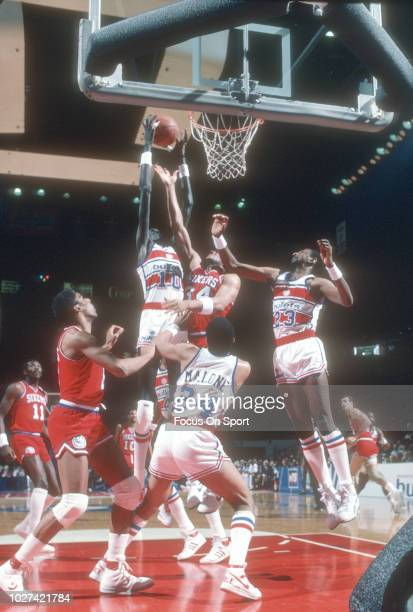 ead7b822ff07 Manute Bol of the Washington Bullets grabs a rebound over Charles Barkley  of the Philadelphia 76ers