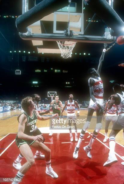 70761161f1c8 Manute Bol of the Washington Bullets in action against the Milwaukee Bucks  during an NBA basketball