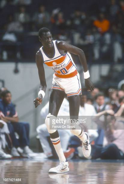 Manute Bol of the Washington Bullets in action against the New York Knicks during an NBA basketball game circa 1986 at the Capital Centre in Landover...