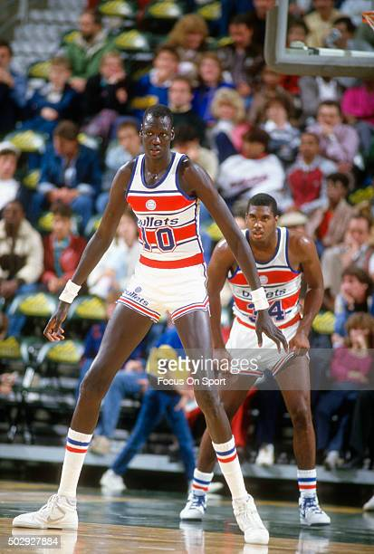 Manute Bol of the Washington Bullets in action during an NBA basketball game circa 1986 at the Capital Centre in Landover Maryland Bol played for the...