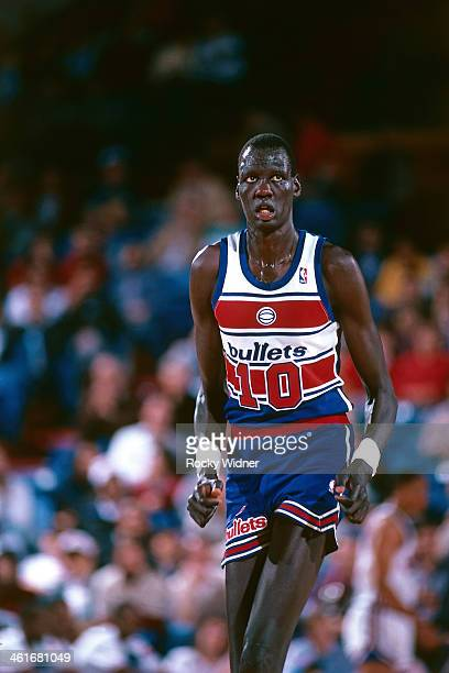 Manute Bol of the Washington Bullets runs during a game played on February 14 1987 at Arco Arena in Sacramento California NOTE TO USER User expressly...