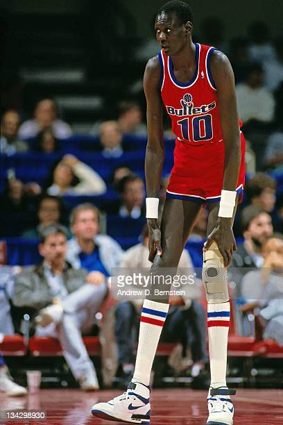 Manute Bol of the Washington Bullets stands against the Los Angeles Clippers circa 1987 at the LA Sports Arena in Los Angeles California NOTE TO USER...