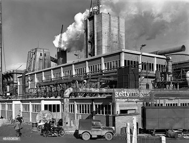 Manvers coal processing plant Wath upon Dearne near Rotherham South Yorkshire January 1957 A worker leans against what looks to be an early 1950s...