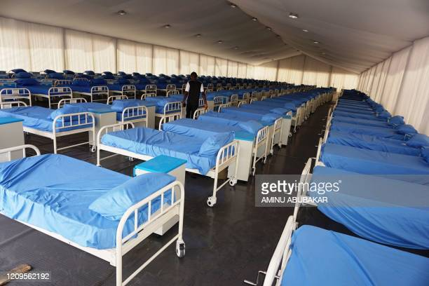 Manwalks between rows of beds inside the male section at a COVID-19 coronavirus isolation centre at the Sani Abacha stadium in Kano, Nigeria, on...