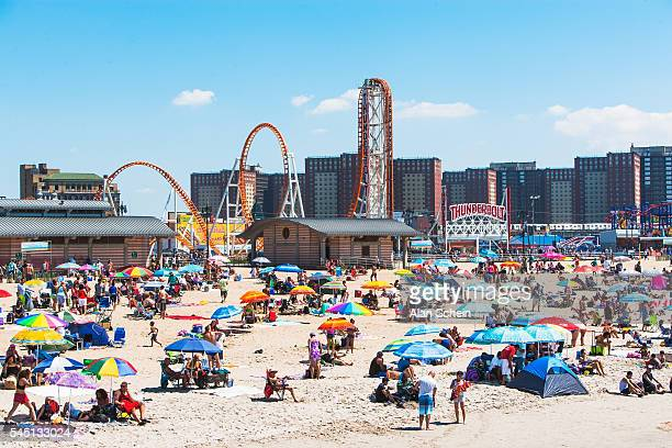 many beach umbrellas at coney island, brooklyn - coney island stock pictures, royalty-free photos & images