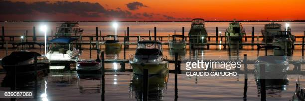 many boats at a cancun marina during the sunset - claudio capucho stock photos and pictures