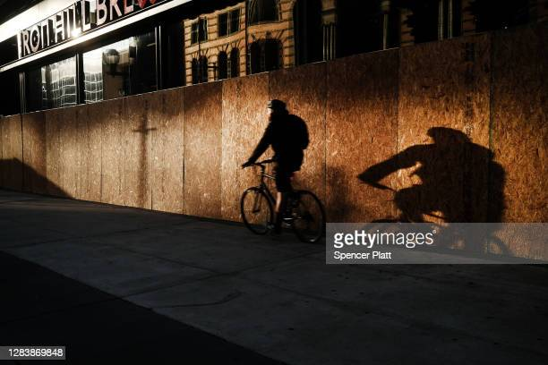 Many buildings remained boarded up along the streets of Philadelphia the morning after Americans voted in the presidential election on November 04,...