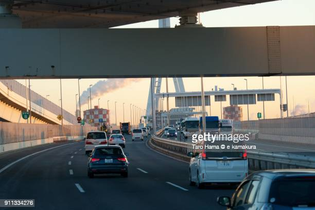 Many cars running on Yokohama Bay Bridge in Yokohama city in Kanagawa prefecture in Japan in the morning