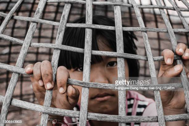 many children are not themselves because of external pressures. - child behind bars stock pictures, royalty-free photos & images
