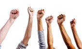 Many clenched fists raised against white background