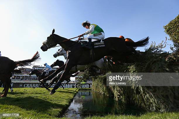 Many Clouds ridden by Leighton Aspell clears the Water Jump on their way to winning the 2015 Crabbie's Grand National at Aintree Racecourse on April...