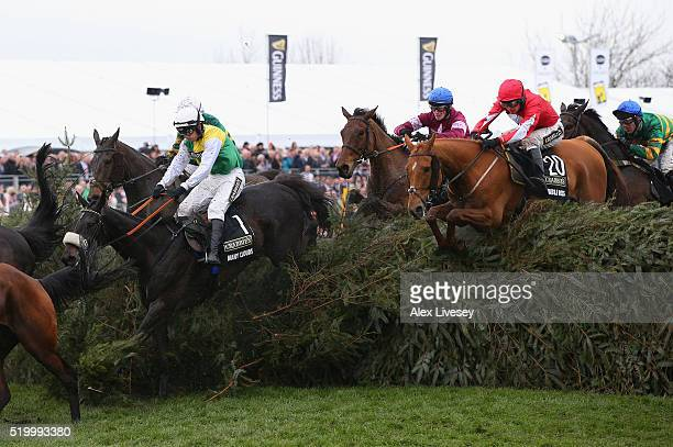 Many Clouds ridden by Leighton Aspell eventual winner Rule The World ridden by David Mullins and Double Ross ridden by Ryan Hatch clear The Chair...