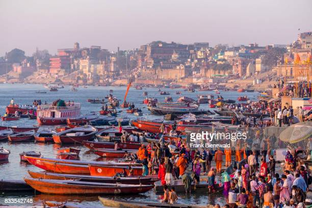 Many colorful rowing boats are tight up at Dashashwamedh Ghat Main Ghat in the suburb Godowlia at the holy river Ganges