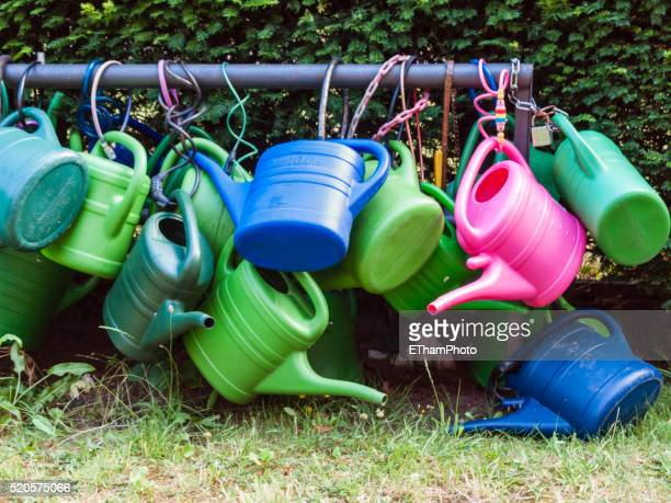 Many coloured watering cans