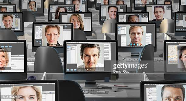 many computers with peoples faces on each screen - large group of people imagens e fotografias de stock