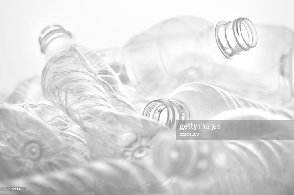 Many crushed plastic bottles placed on a white or transparent background : Stock Photo