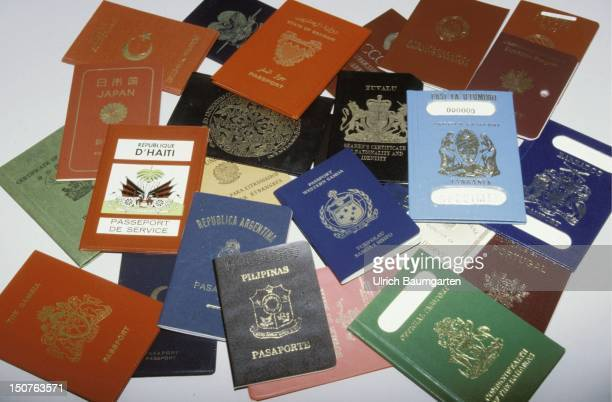 Many different foreign passports in a pile
