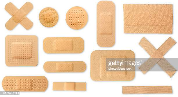 many different plasters with clipping paths - bandage stock photos and pictures