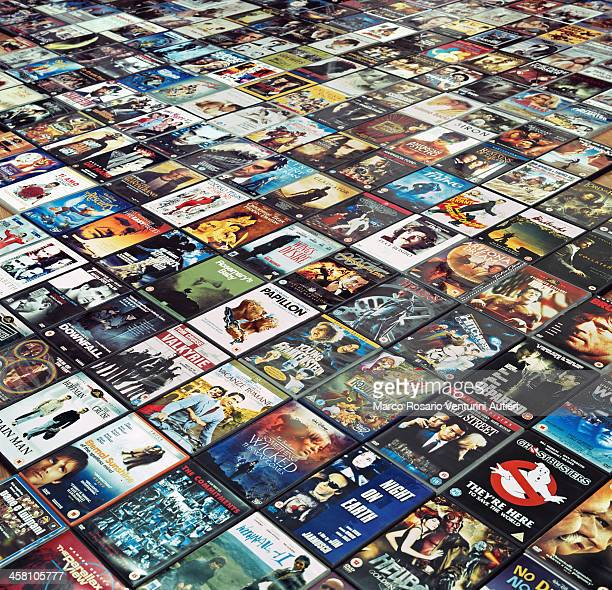 many dvds are arranged side by side on the floor - neat video stock pictures, royalty-free photos & images