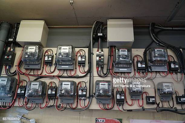 Many electric switchboards on the wall
