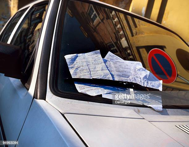 Many fines on the windscreen of a parked car