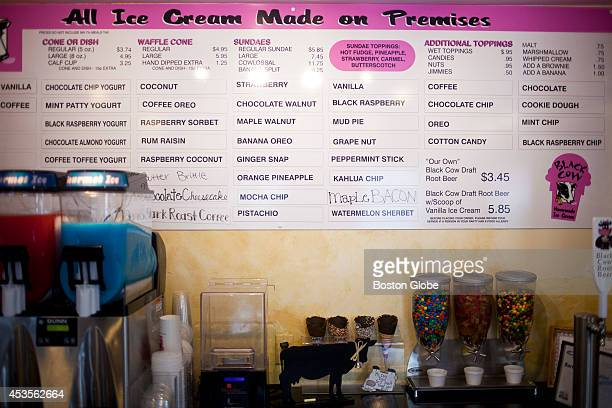 Many flavors of ice cream and milkshakes are displayed on the menu board at Black Cow Ice Cream on August 8 2014 in Millis Mass